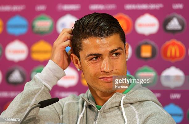 L'VIV UKRAINE JUNE 08 In this handout image provided by UEFA Cristiano Ronaldo of Portugal talks to the media during a UEFA EURO 2012 press...