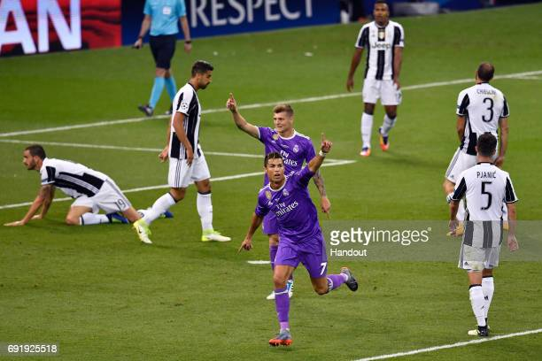 In this handout image provided by UEFA Cristiano Ronaldo of Real Madrid celebrates scoring his sides first goal during the UEFA Champions League...