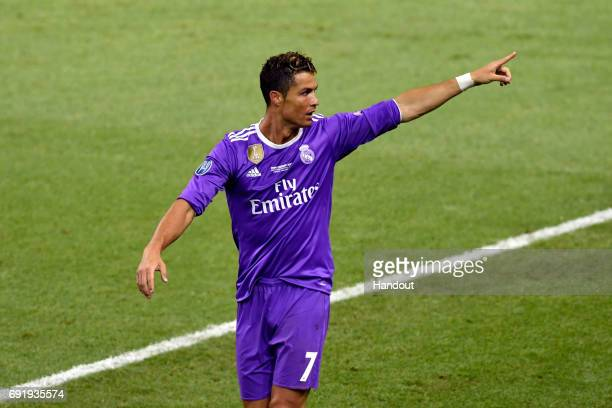 In this handout image provided by UEFA Cristiano Ronaldo of Real Madrid celebrates scoring his sides third goal during the UEFA Champions League...