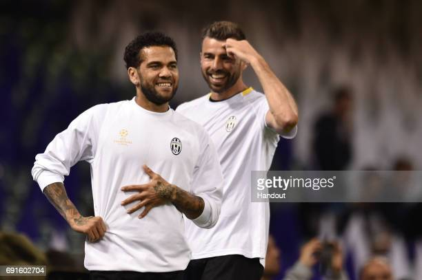 In this handout image provided by UEFA Dani Alves of Juventus smiles during a training session prior to the UEFA Champions League Final between...