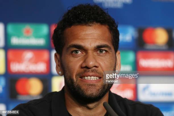 In this handout image provided by UEFA Dani Alves of Juventus talks during a press conference prior to the UEFA Champions League Final between...