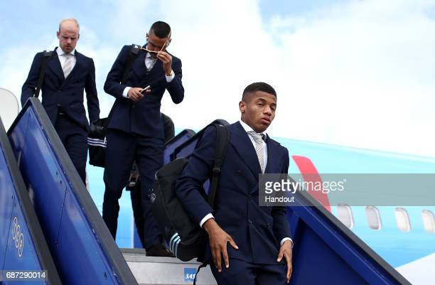 In this handout image provided by UEFA David Neres of Ajax arrives with team mates ahead of the UEFA Europa League Final between Ajax and Manchester...