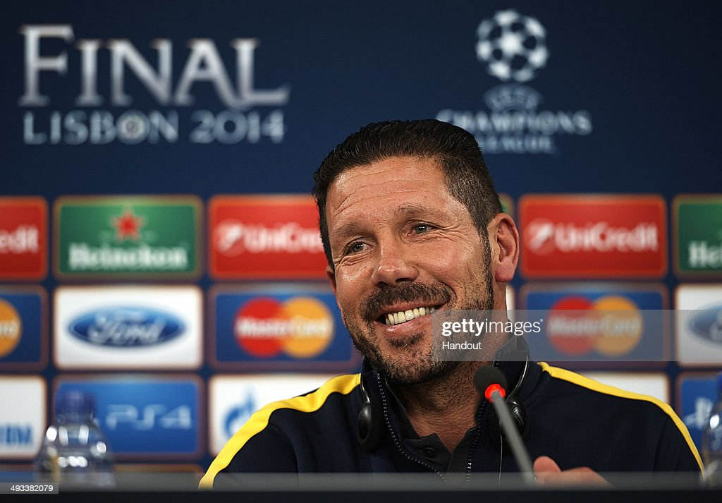 In this handout image provided by UEFA, <a gi-track='captionPersonalityLinkClicked' href=/galleries/search?phrase=Diego+Simeone&family=editorial&specificpeople=226872 ng-click='$event.stopPropagation()'>Diego Simeone</a>, coach of Club Atletico de Madrid attends a press conference ahead of the UEFA Champions League final against Real Madrid at Estadio da Luz on May 23, 2014 in Lisbon, Portugal.