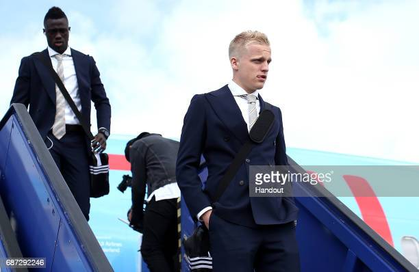 In this handout image provided by UEFA Donny van de Beek of Ajax arrives with team mates ahead of the UEFA Europa League Final between Ajax and...