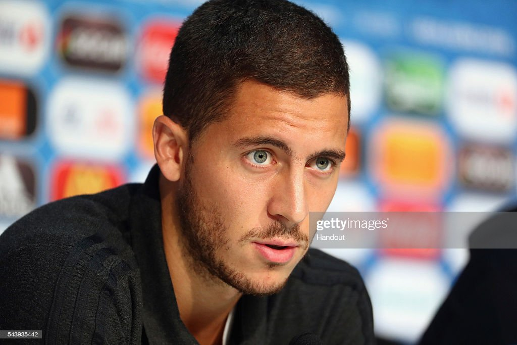 In this handout image provided by UEFA <a gi-track='captionPersonalityLinkClicked' href=/galleries/search?phrase=Eden+Hazard&family=editorial&specificpeople=5539543 ng-click='$event.stopPropagation()'>Eden Hazard</a> of Belgium attends a press conference at Stade Pierre Mauroy on June 30, 2016 in Lille, France.
