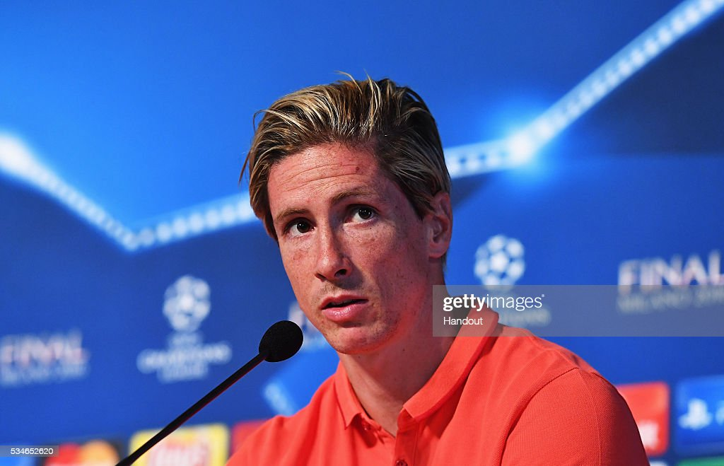 In this handout image provided by UEFA <a gi-track='captionPersonalityLinkClicked' href=/galleries/search?phrase=Fernando+Torres&family=editorial&specificpeople=194755 ng-click='$event.stopPropagation()'>Fernando Torres</a> of Atletico Madrid talks to the media during Atletico de Madrid press conference on the eve of the UEFA Champions League Final against Real Madrid at Stadio Giuseppe Meazza on May 27, 2016 in Milan, Italy.