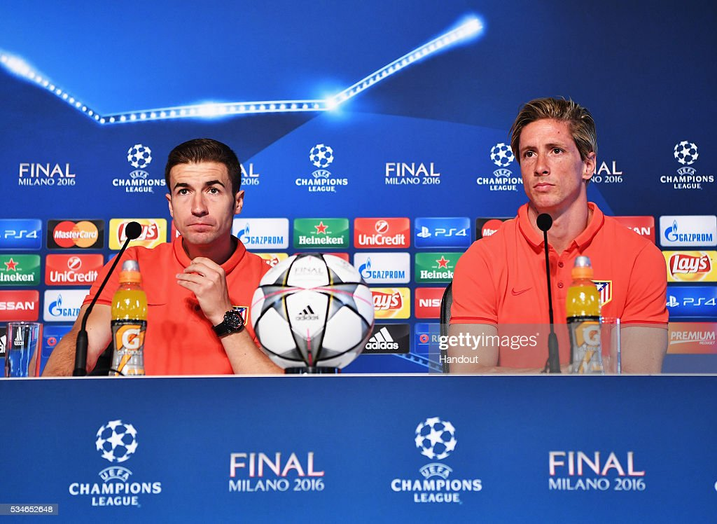 In this handout image provided by UEFA <a gi-track='captionPersonalityLinkClicked' href=/galleries/search?phrase=Gabi+-+Soccer+Player&family=editorial&specificpeople=6912055 ng-click='$event.stopPropagation()'>Gabi</a>, captain of Atletico Madrid and <a gi-track='captionPersonalityLinkClicked' href=/galleries/search?phrase=Fernando+Torres&family=editorial&specificpeople=194755 ng-click='$event.stopPropagation()'>Fernando Torres</a> talk to the media during Atletico de Madrid press conference on the eve of the UEFA Champions League Final against Real Madrid at Stadio Giuseppe Meazza on May 27, 2016 in Milan, Italy.