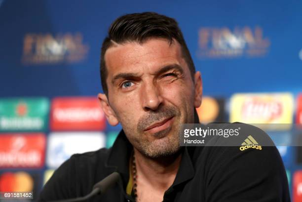 In this handout image provided by UEFA Gianluigi Buffon of Juventus talks during a press conference prior to the UEFA Champions League Final between...