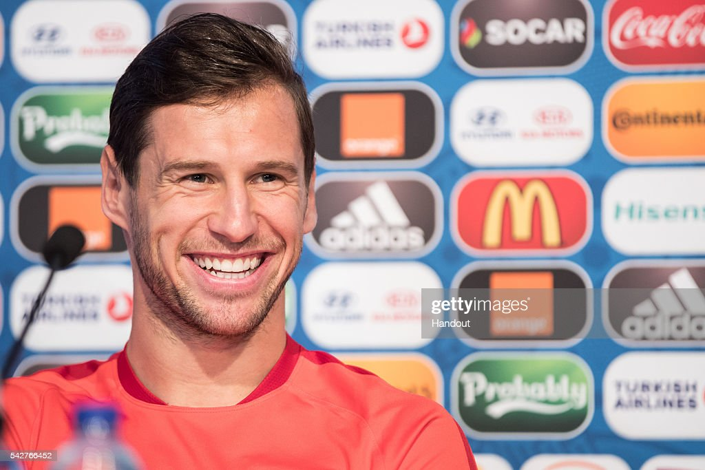 In this handout image provided by UEFA, <a gi-track='captionPersonalityLinkClicked' href=/galleries/search?phrase=Grzegorz+Krychowiak&family=editorial&specificpeople=4379669 ng-click='$event.stopPropagation()'>Grzegorz Krychowiak</a> of Poland attends a press conference on June 21, 2016 in Saint-Etienne, France.