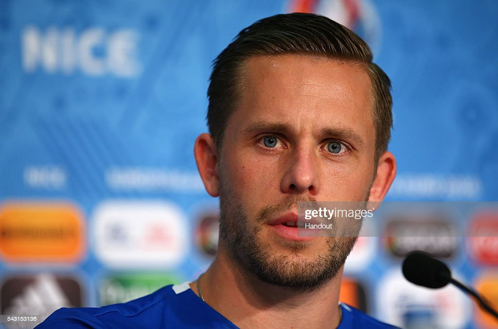 In this handout image provided by UEFA, <a gi-track='captionPersonalityLinkClicked' href=/galleries/search?phrase=Gylfi+Sigurdsson&family=editorial&specificpeople=6401581 ng-click='$event.stopPropagation()'>Gylfi Sigurdsson</a> faces the media during the Iceland press conference at Allianz Riviera Stadium on June 26, 2016 in Nice, France.