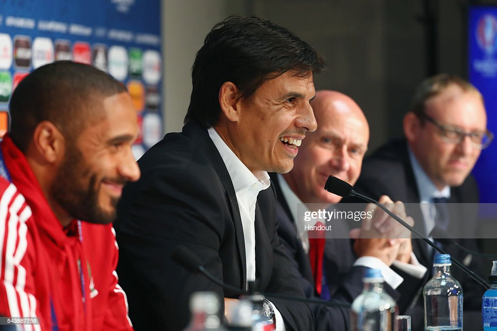 In this handout image provided by UEFA, head coach Chris Coleman and <a gi-track='captionPersonalityLinkClicked' href=/galleries/search?phrase=Ashley+Williams+-+Soccer+Player&family=editorial&specificpeople=13495389 ng-click='$event.stopPropagation()'>Ashley Williams</a> of Wales attend a press conference at Stade Pierre Mauroy on June 30, 2016 in Lille, France.