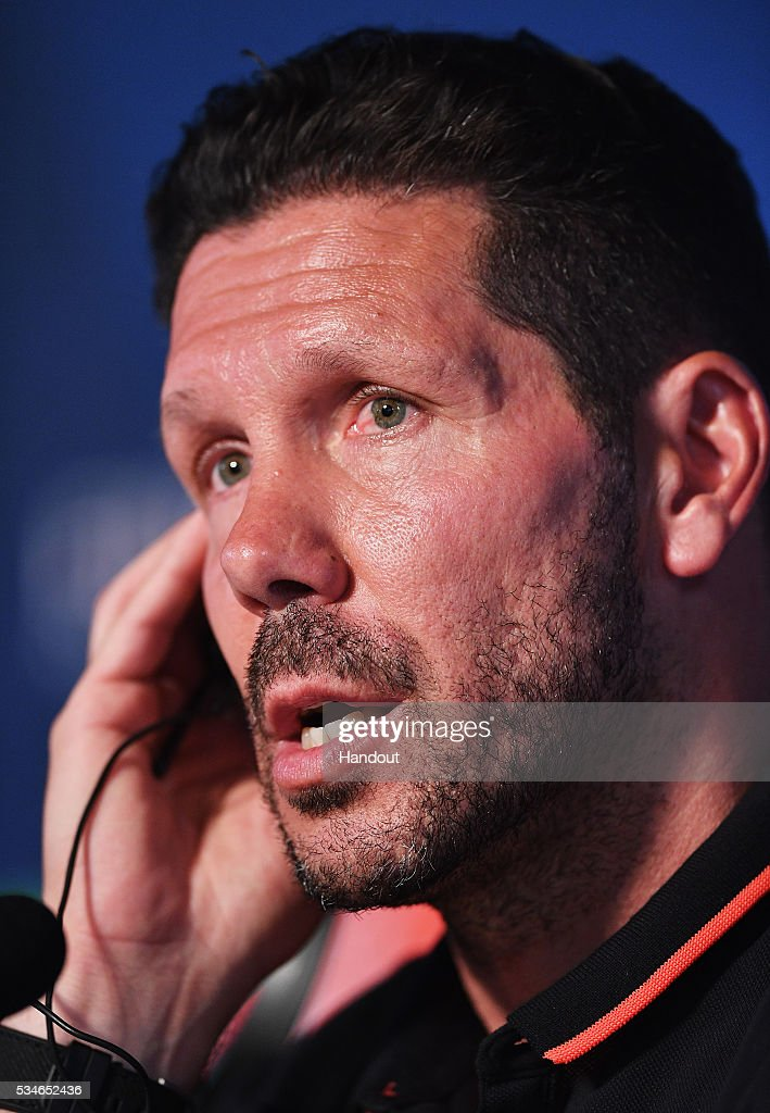 In this handout image provided by UEFA Head coach <a gi-track='captionPersonalityLinkClicked' href=/galleries/search?phrase=Diego+Simeone&family=editorial&specificpeople=226872 ng-click='$event.stopPropagation()'>Diego Simeone</a> of Atletico Madrid talks to the media during a Atletico de Madrid press conference on the eve of the UEFA Champions League Final against Real Madrid at Stadio Giuseppe Meazza on May 27, 2016 in Milan, Italy.