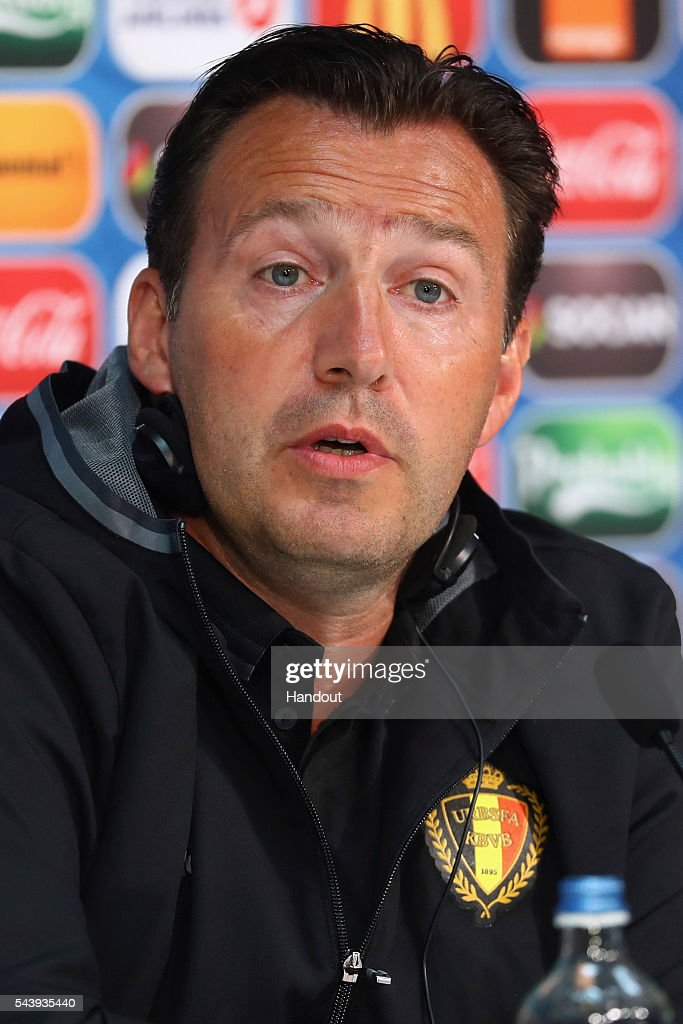 In this handout image provided by UEFA head coach <a gi-track='captionPersonalityLinkClicked' href=/galleries/search?phrase=Marc+Wilmots&family=editorial&specificpeople=1016207 ng-click='$event.stopPropagation()'>Marc Wilmots</a> of Belgium attends a press conference at Stade Pierre Mauroy on June 30, 2016 in Lille, France.