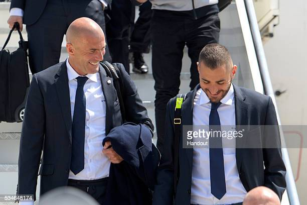 In this handout image provided by UEFA Head coach Zinedine Zidane of Real Madrid and Karim Benzema arriving at Malpensa airport ahead of the UEFA...