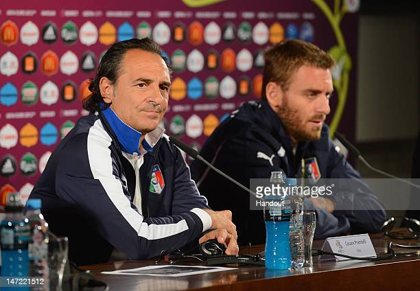 In this handout image provided by UEFA Italy coach Cesare Prandelli speaks beside Daniele De Rossi during a press conference ahead of their UEFA EURO...