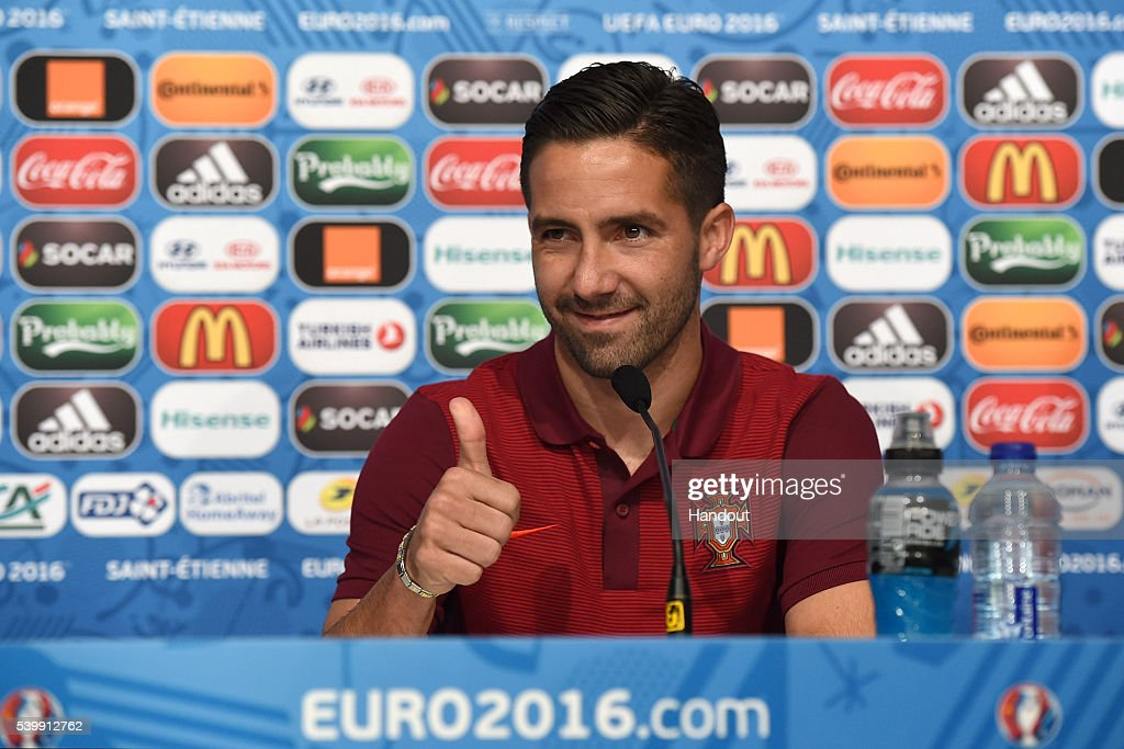 In this handout image provided by UEFA, Joao Moutinho of Portugal faces the media during the Portugal press conference on June 13, 2016 in Saint-Etienne, France.