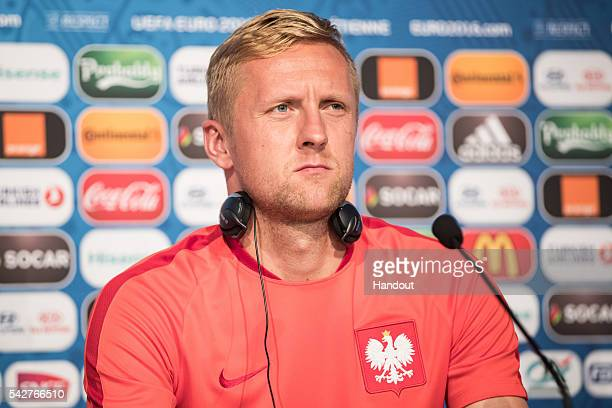 In this handout image provided by UEFA Kamil Glik of Poland attends a press conference on June 21 2016 in SaintEtienne France