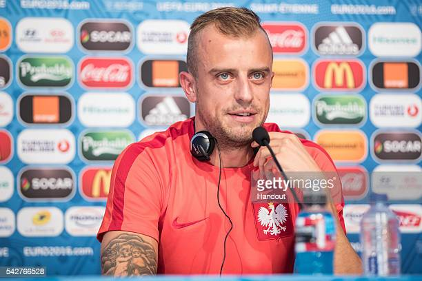 In this handout image provided by UEFA Kamil Grosicki of Poland attends a press conference on June 21 2016 in SaintEtienne France Picture credit UEFA