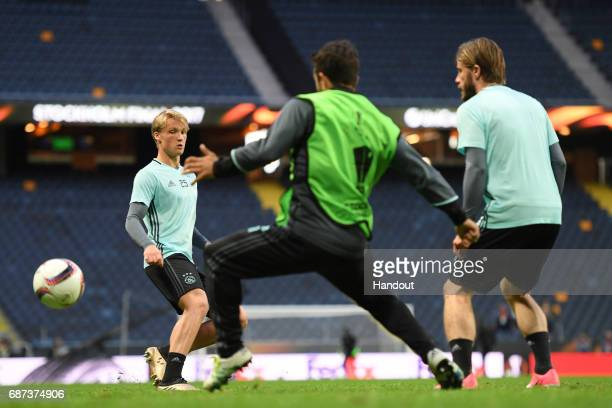 In this handout image provided by UEFA Kasper Dolberg of Ajax in action during a training session at The Friends Arena ahead of the UEFA Europa...
