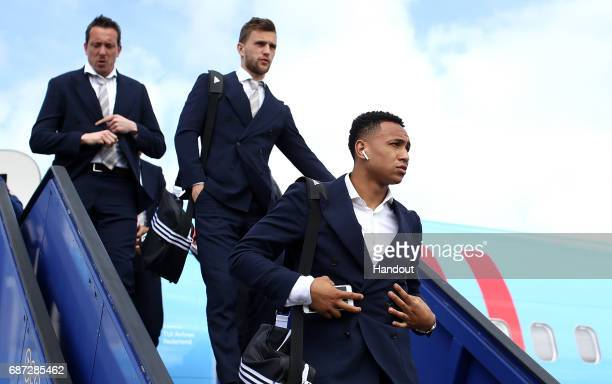 In this handout image provided by UEFA Kenny Tete of Ajax arrives with team mates ahead of the UEFA Europa League Final between Ajax and Manchester...