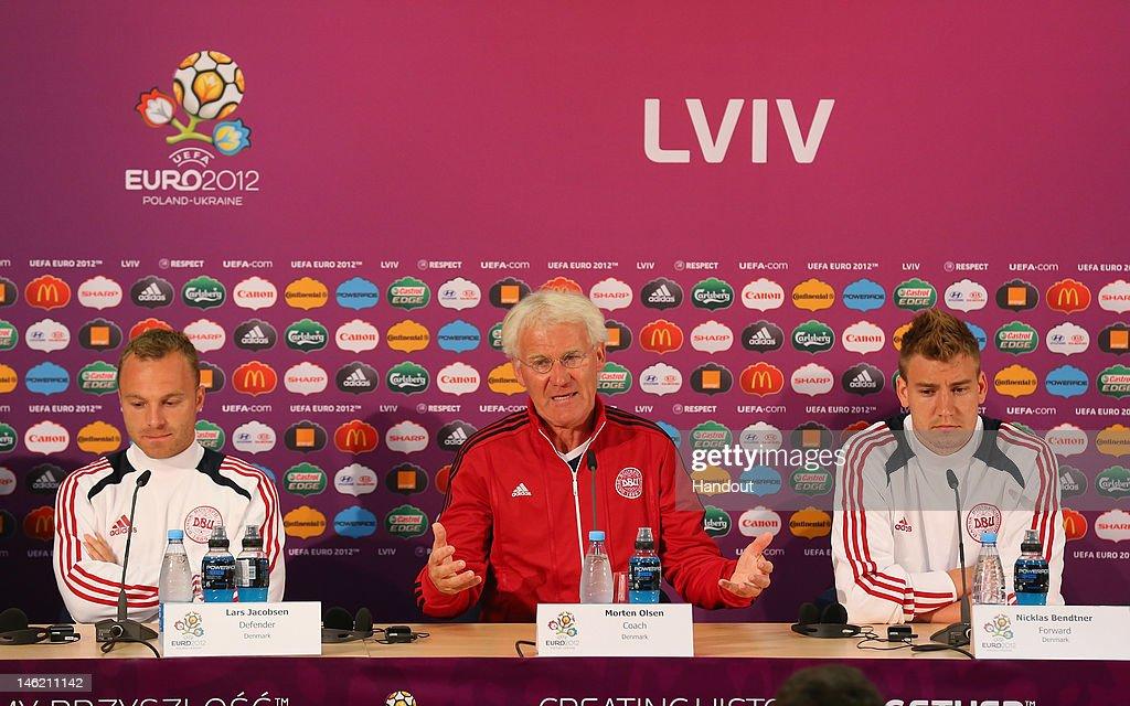 L'VIV UKRAINE JUNE 12 In this handout image provided by UEFA Lars Jacobsen Morten Olsen the coach of Denmark and Nicklas Bendtner face the media...