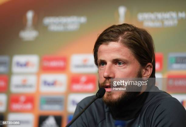 In this handout image provided by UEFA Lasse Schoene of Ajax speaks to the media during the press conference at The Friends Arena ahead of the UEFA...