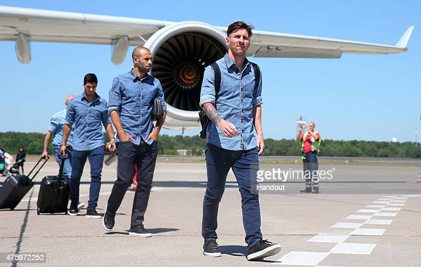 In this handout image provided by UEFA Lionel Messi Javier Mascherano and Luis Suarez of Barcelona arrive on the eve of the UEFA Champions League...
