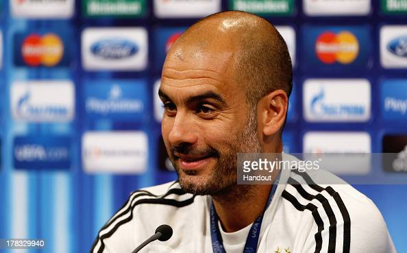 In this handout image provided by UEFA Manager Josep Guardiola of Bayern Munich talks to the media prior to the UEFA Super Cup match between Bayern...