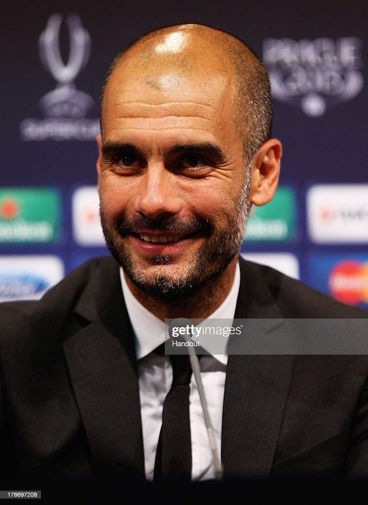 In this handout image provided by UEFA, Manager <a gi-track='captionPersonalityLinkClicked' href=/galleries/search?phrase=Josep+Guardiola&family=editorial&specificpeople=2088964 ng-click='$event.stopPropagation()'>Josep Guardiola</a> of Bayern Munich talks to the media after the UEFA Super Cup match between Bayern Muenchen and Chelsea FC at Stadion Eden on August 30, 2013 in Prague, Czech Republic.