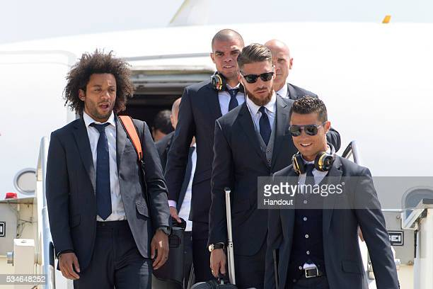 In this handout image provided by UEFA Marcelo Pepe Sergio Ramos and Cristiano Ronaldo of Real Madrid arriving at Malpensa airport ahead of the UEFA...