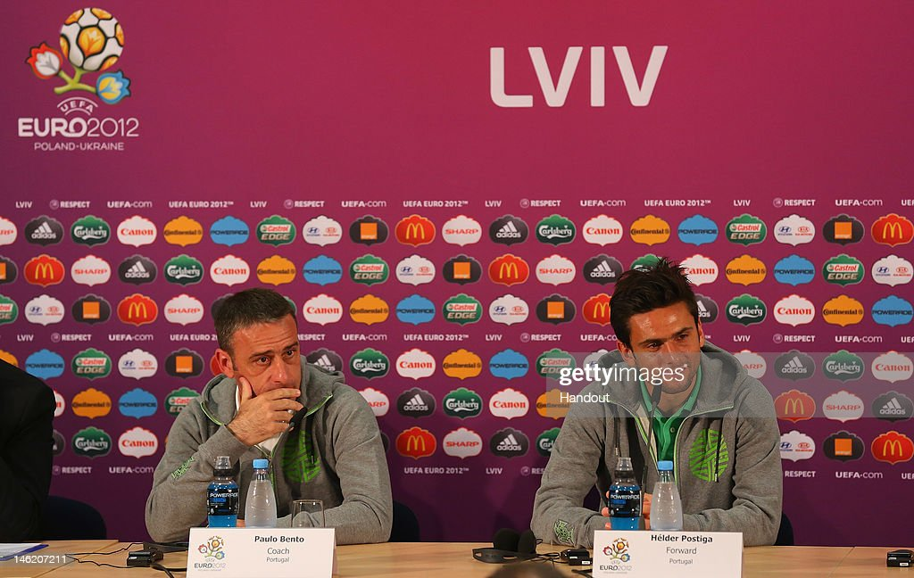 L'VIV, UKRAINE - JUNE 12: In this handout image provided by UEFA, (L-R) <a gi-track='captionPersonalityLinkClicked' href=/galleries/search?phrase=Paulo+Bento&family=editorial&specificpeople=2076425 ng-click='$event.stopPropagation()'>Paulo Bento</a> the coach of Portugal and <a gi-track='captionPersonalityLinkClicked' href=/galleries/search?phrase=Helder+Postiga&family=editorial&specificpeople=227423 ng-click='$event.stopPropagation()'>Helder Postiga</a> talk to the media during a UEFA EURO 2012 press conference at the Arena Lviv on June 12, 2012 in Lviv, Ukraine.