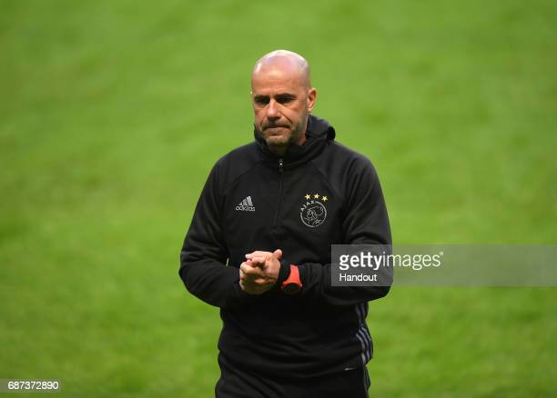 In this handout image provided by UEFA Peter Bosz Manager of Ajax looks on during a training session at The Friends Arena ahead of the UEFA Europa...