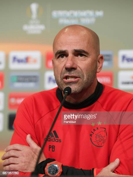 In this handout image provided by UEFA Peter Bosz Manager of Ajax speaks to the media during the press conference at The Friends Arena ahead of the...