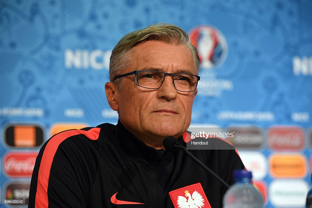 In this handout image provided by UEFA, Poland manager Adam Nawalka faces the media at the Poland press conference on June 11, 2016 in Nice, France.