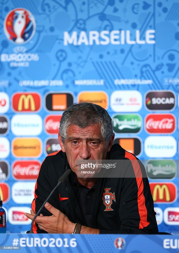 In this handout image provided by UEFA, Portugal coach <a gi-track='captionPersonalityLinkClicked' href=/galleries/search?phrase=Fernando+Santos+-+Soccer+Coach&family=editorial&specificpeople=9459592 ng-click='$event.stopPropagation()'>Fernando Santos</a> faces the media during the Portugal press conference at Stade Velodrome on June 29, 2016 in Marseille, France.