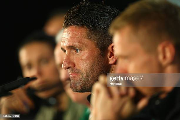 In this handout image provided by UEFA Robbie Keane of Republic of Ireland talks to the media during a UEFA EURO 2012 press conference ahead of the...