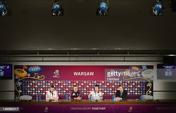 In this handout image provided by UEFA Russia coach Dick Advocaat and Alan Dzagoev of Russia talk to the media during a UEFA EURO 2012 press...