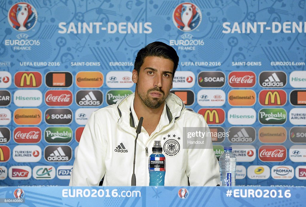 In this handout image provided by UEFA, <a gi-track='captionPersonalityLinkClicked' href=/galleries/search?phrase=Sami+Khedira&family=editorial&specificpeople=2513712 ng-click='$event.stopPropagation()'>Sami Khedira</a> of Germany addresses the media during a Germany press conference on June 15, 2016 in Paris, France.