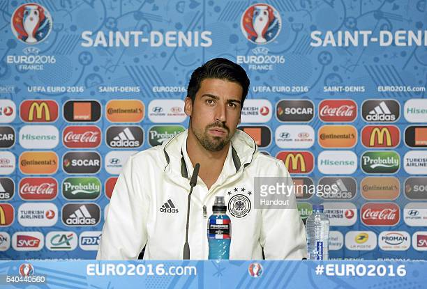 In this handout image provided by UEFA Sami Khedira of Germany addresses the media during a Germany press conference on June 15 2016 in Paris France