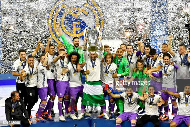In this handout image provided by UEFA Sergio Ramos of Real Madrid lifts The Champions League trophy after the UEFA Champions League Final between...