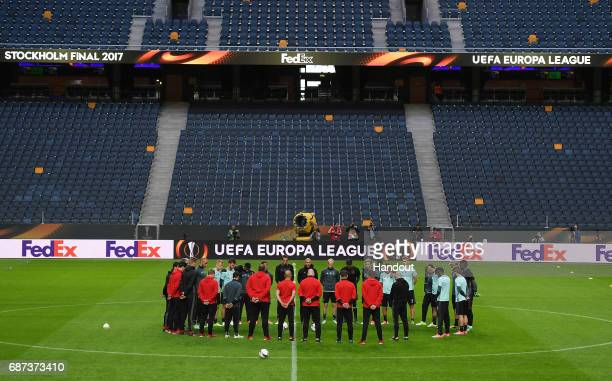 In this handout image provided by UEFA The Ajax players and staff take part in a minutes silence in memroy of the victims of the Manchester Concert...