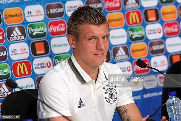 In this handout image provided by UEFA Toni Kroos of Germany talks during the Germany press conference on June 11 2016 in Lille France