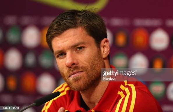 In this handout image provided by UEFA Xabi Alonso of Spain talks to the media after the UEFA EURO 2012 Quarter Final match between Spain and France...