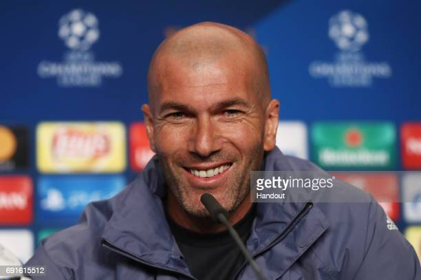 In this handout image provided by UEFA Zinedine Zidane coach of Real Madrid smiles during a press conference prior to the UEFA Champions League Final...