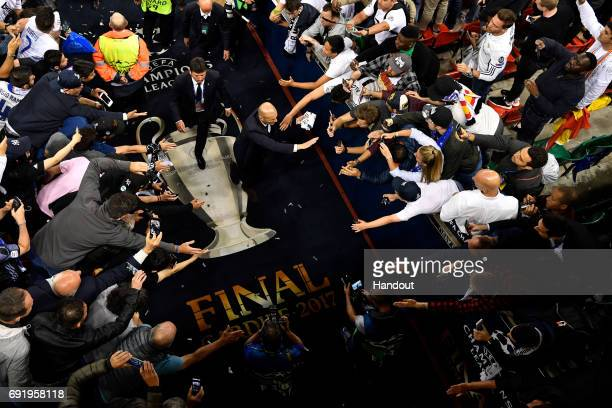 In this handout image provided by UEFA Zinedine Zidane coach of Real Madrid walks back to the dressing room after the UEFA Champions League Final...