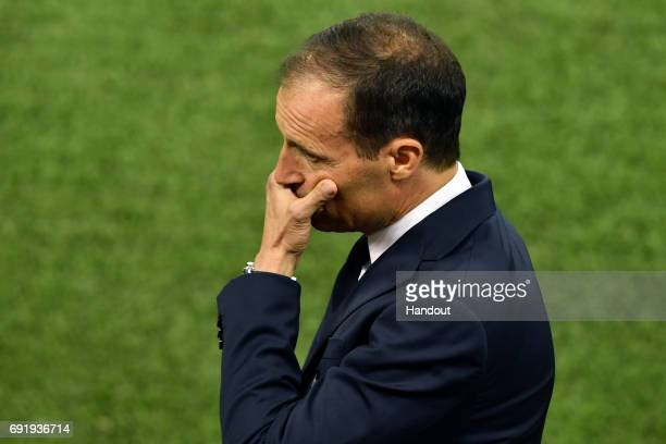 In this handout image provided by UEFAMassimiliano Allegri Manager of Juventus reacts during the UEFA Champions League Final between Juventus and...