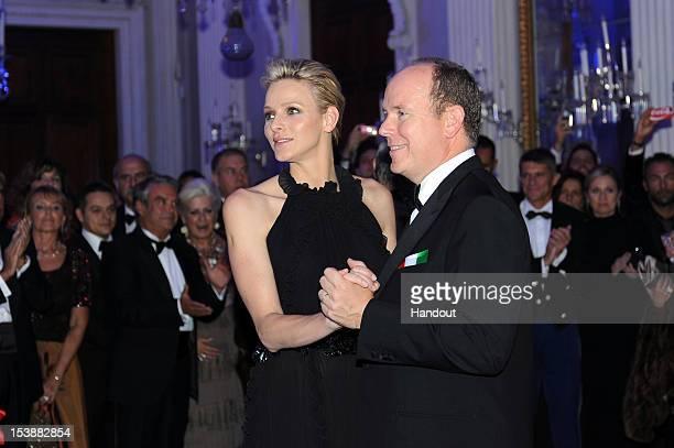 In this handout image provided by Ufficio Stampa Ballo del Giglio Prince Albert of Monaco and princess Charlene of Monaco attend the 2012 Ballo del...