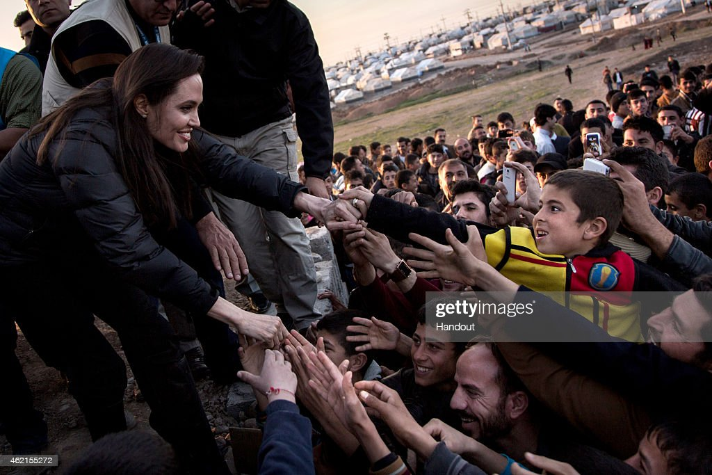In this handout image provided by UNHCR, UNHCR Special Envoy <a gi-track='captionPersonalityLinkClicked' href=/galleries/search?phrase=Angelina+Jolie&family=editorial&specificpeople=201591 ng-click='$event.stopPropagation()'>Angelina Jolie</a> meets members of the Yazidi minority in Khanke IDP Camp on January 25, 2015 in Khanke, Iraq. <a gi-track='captionPersonalityLinkClicked' href=/galleries/search?phrase=Angelina+Jolie&family=editorial&specificpeople=201591 ng-click='$event.stopPropagation()'>Angelina Jolie</a> was visiting Syrian refugees and displaced Iraqi citizens in the Kurdistan Region of Iraq to offer support to 3.3 million displaced people in the country and highlight their dire needs.
