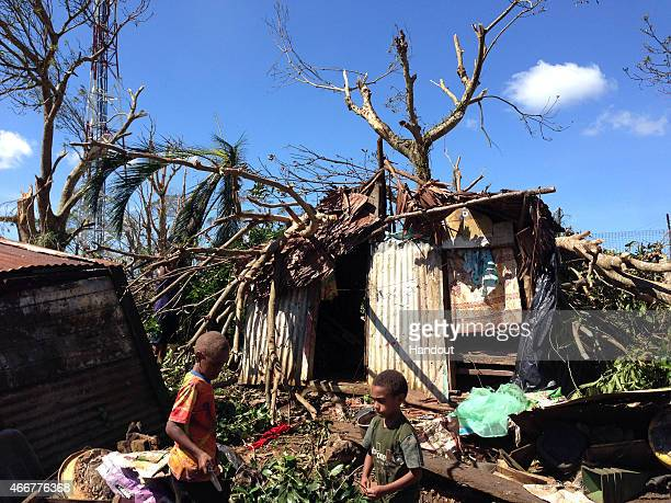 In this handout image provided by UNICEF children stand outside the remains of their homes after Cyclone Pam hit their village on March 17 2015 in...