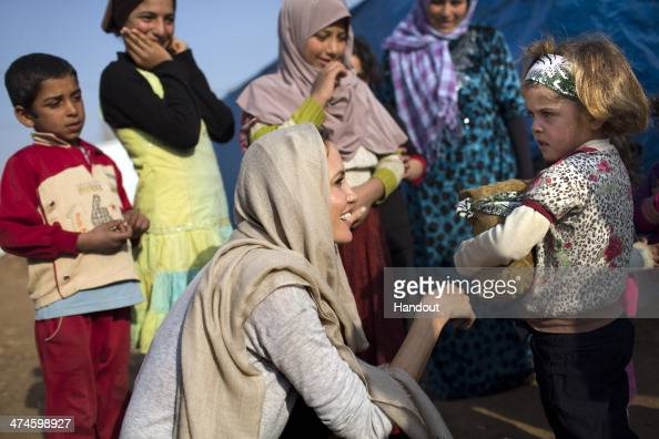 In this handout image provided by United Nations High Commission for Refugees UNHCR Special Envoy Angelina Jolie meets with young Syrian refugees at...